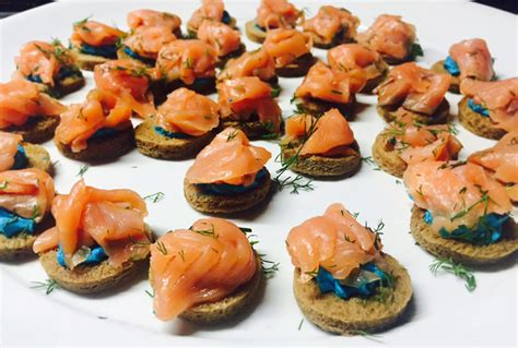 Delicious canapés with smoked salmon and blue cream cheese